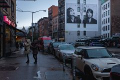 Winona Ryder Mural in distance. Rainy day on the Lafayette Street in SoHo in Lower Manhattan Street Photography with Fujifilm.