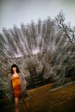 Glamour Photography photo shoot with young woman posing in front of Ai Weiwei's Forever Bicycles in Austin Texas for Glamour Photography photo shoot.