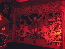 Inside the red stairwell at the Le Bain at the Standard Hotel in Manhattan, with murals inside.