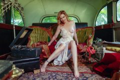 Woman posing seductive in nude in an abandoned bus at Sekrit Theater in Austin