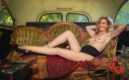 Woman posing in boudoir in an abandoned bus at Sekrit Theater in Austin
