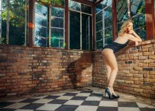 Seductive boudoir pictures of woman wearing black lingerie posing in the greenhouse at the sekrit theater in austin
