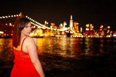 Plus size boudoir photo shoot for a BBW model at DUMBO Brooklyn in NYC with Manhattan Bridge and Empire State Building in background