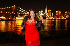 Plus size boudoir photo shoot for a BBW model in Brooklyn Bridge Park in NYC with Brooklyn Bridge and Lower Manhattan Skyline in background